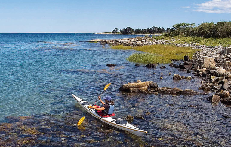 A kayaker explores one of the islands on the trail.