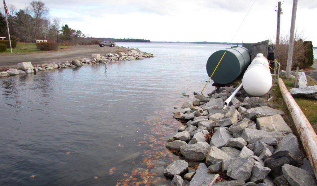 Fuel tanks sit close to the water during a high-tide event in Lincolnville Beach.
