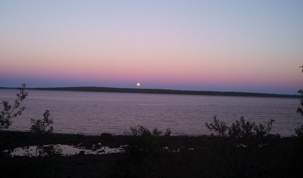 The full moon rises over Islesboro.