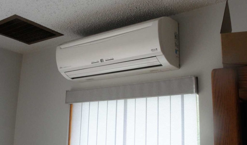 The interior part of an air-source heat pump includes a fan that blows across the heated coils.