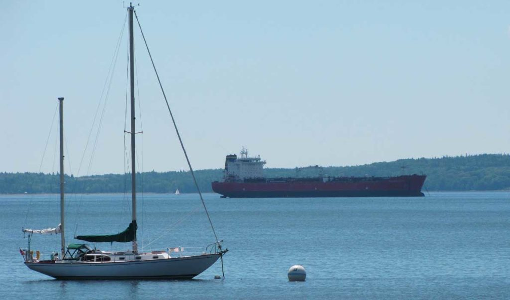 A sailboat and cargo ship share the waters off Searsport.