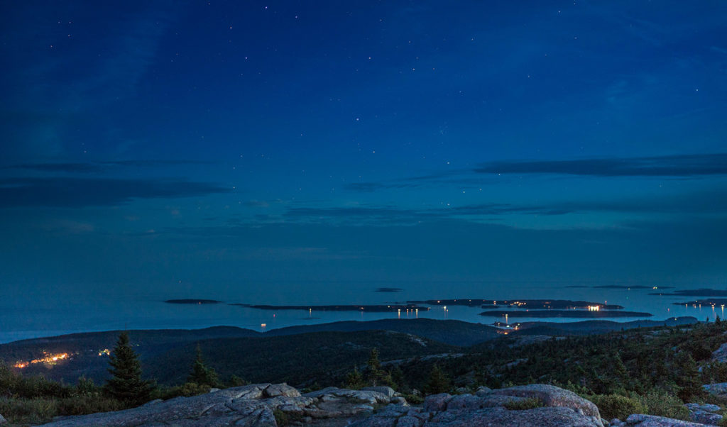 Night sky from Cadillac Mountain with the Cranberry Isles in view.