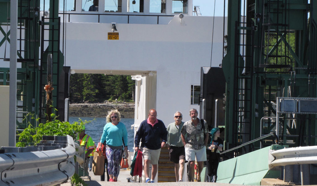 Passengers disembark from the Islesboro ferry in Lincolnville Beach.