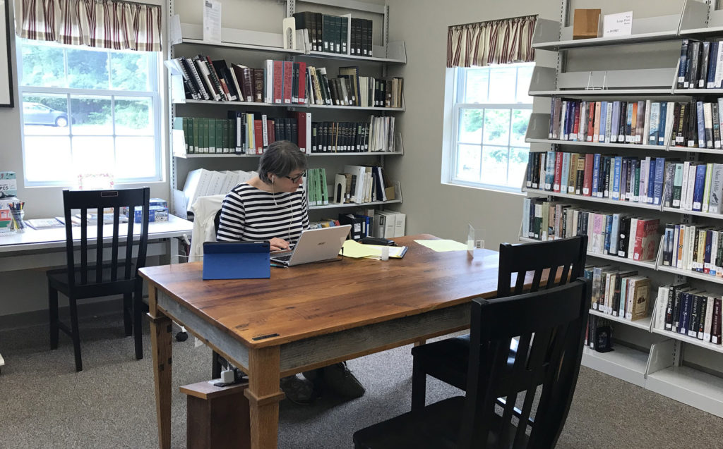 A patron takes advantage of the high speed Internet at Waldoboro Library.