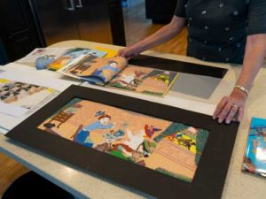Merz demonstrates how she layered fabric and other material to create the Illustrations.